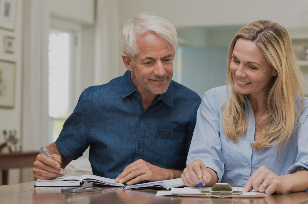 middle-aged couple planning for retirement together