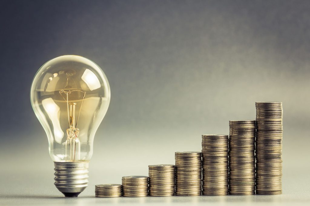 lightbulb and staircase of coins - economy and finance concept