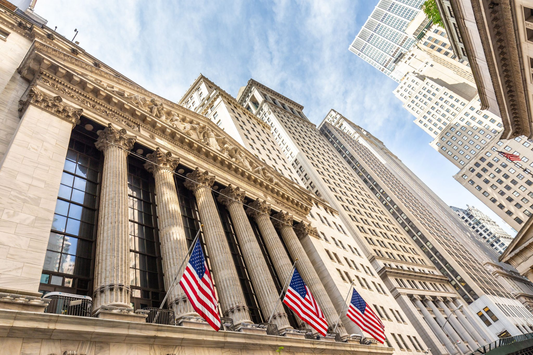 stock exchange building with American flags out front