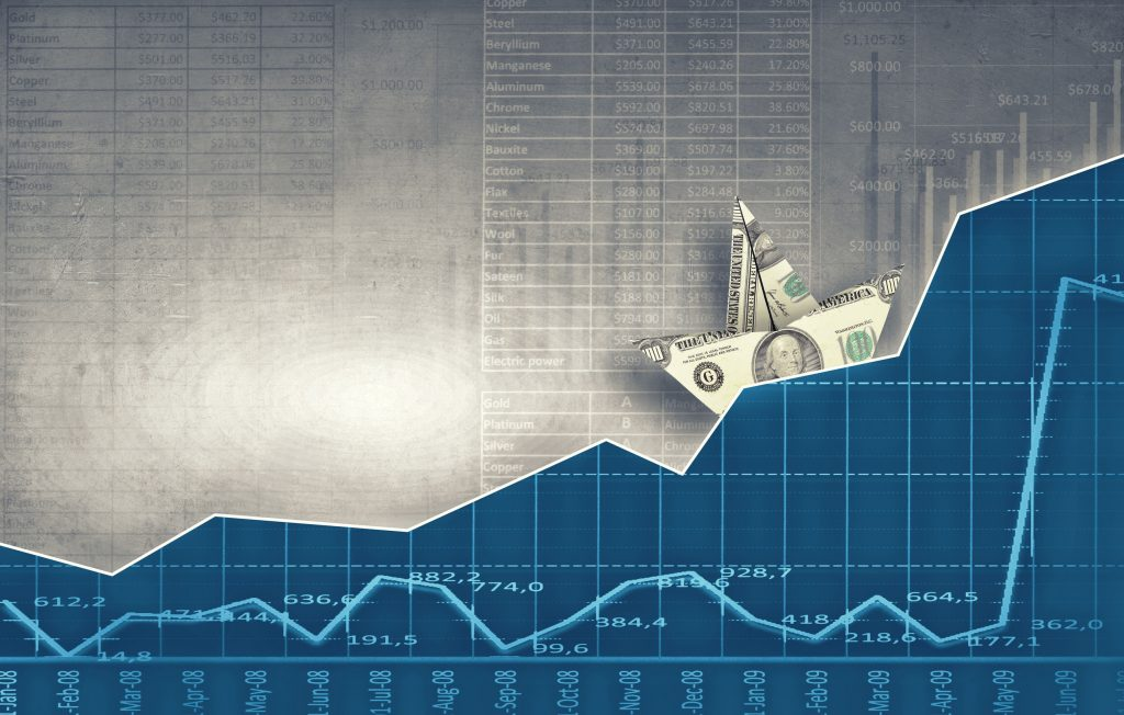 money as a paper boat on a blue wave background with stock chart