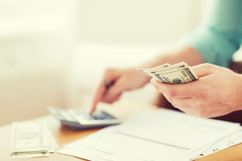 planning and calculating finances with money in hand