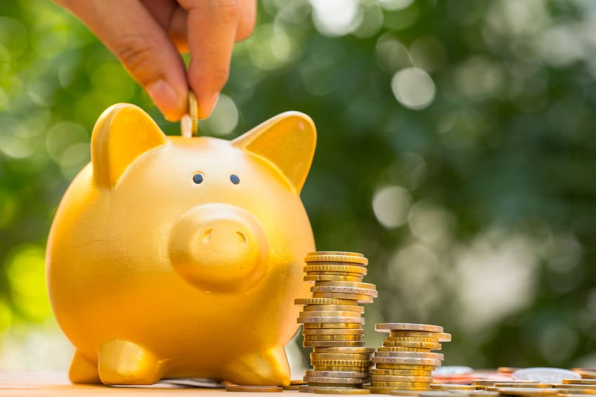 saving and investing in a piggy bank